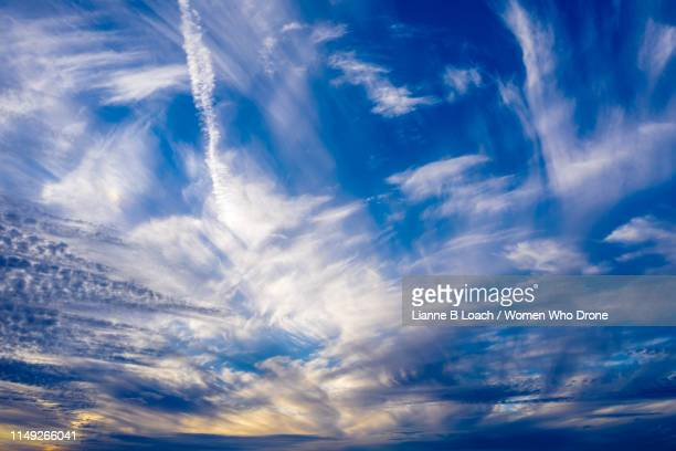 wispy cloud - lianne loach stock pictures, royalty-free photos & images