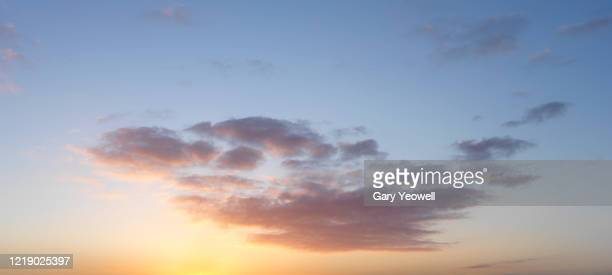wispy clouds at sunset - dusk stock pictures, royalty-free photos & images