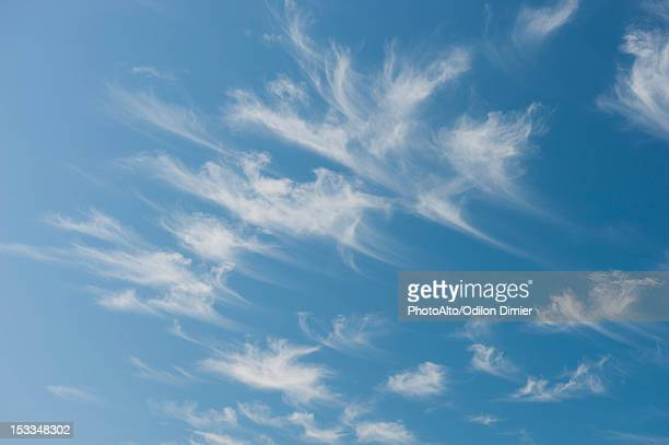 wispy clouds in blue sky - wispy stock photos and pictures