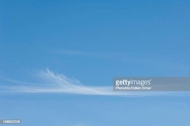 Wispy clouds in blue sky