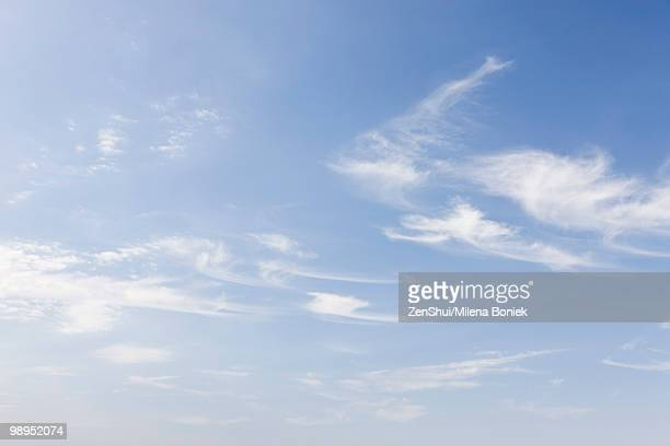 Wispy clouds in blue sky