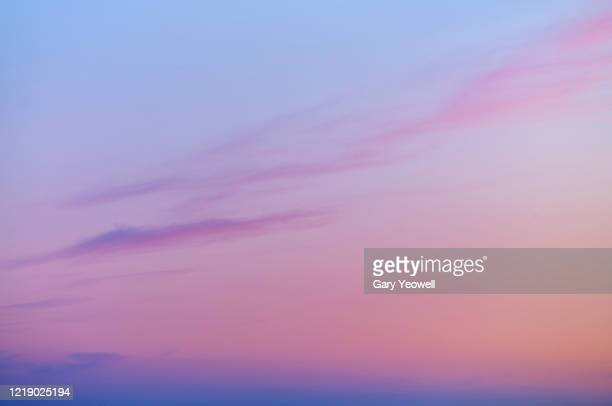 wispy clouds in the sky - sunset stock pictures, royalty-free photos & images