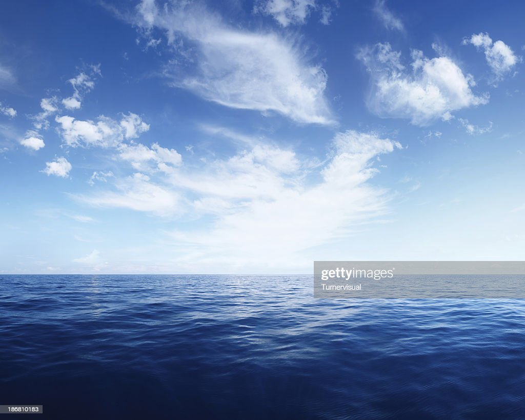 Wispy Clouds over Deep Blue Ocean : Stock Photo