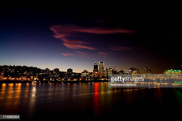wispy clouds over portland, oregon skyline at night - willamette river stock photos and pictures