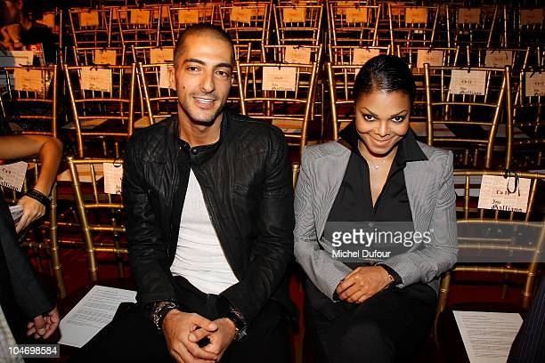 Wissam Al Mana and Janet Jackson attend the John Galliano Ready to Wear Spring/Summer 2011 show during Paris Fashion Week at Opera Comique on October...