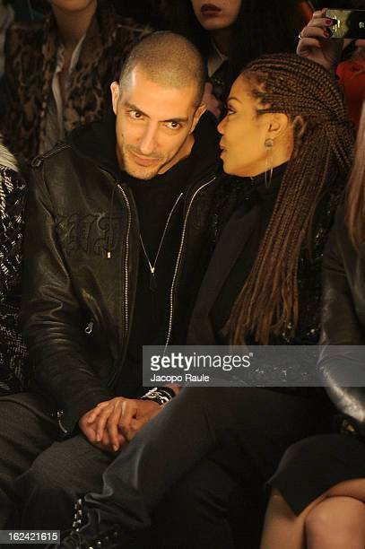 Wissam al Mana and Janet Jackson attend the Roberto Cavalli fashion show as part of Milan Fashion Week Womenswear Fall/Winter 2013/14 on February 23...
