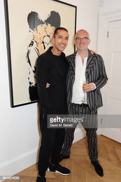 Wissam Al Mana and Joe Corre attend the Bansky 'Greatest Hits 20022008' exhibition VIP preview at Lazinc on July 9 2018 in London England