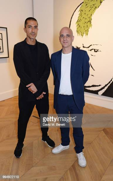 Wissam Al Mana and Steve Lazarides attend the Bansky 'Greatest Hits 20022008' exhibition VIP preview at Lazinc on July 9 2018 in London England