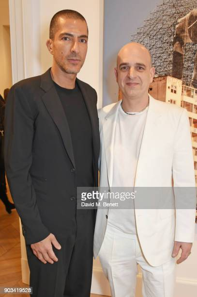 Wissam Al Mana and Steve Lazarides attend the private view of 'JR Giants Body of Work' at Lazinc on January 10 2018 in London England