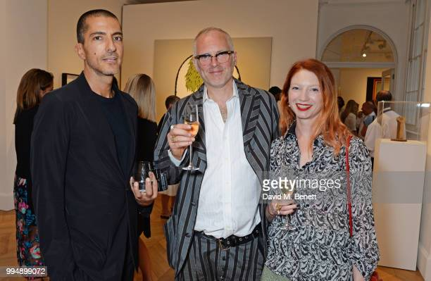 Wissam al Mana Joe Corre and Claire English attend the Bansky 'Greatest Hits 20022008' exhibition VIP preview at Lazinc on July 9 2018 in London...
