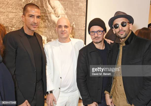 Wissam Al Mana Steve Lazarides Jonathan Yeo and JR attend the private view of 'JR Giants Body of Work' at Lazinc on January 10 2018 in London England