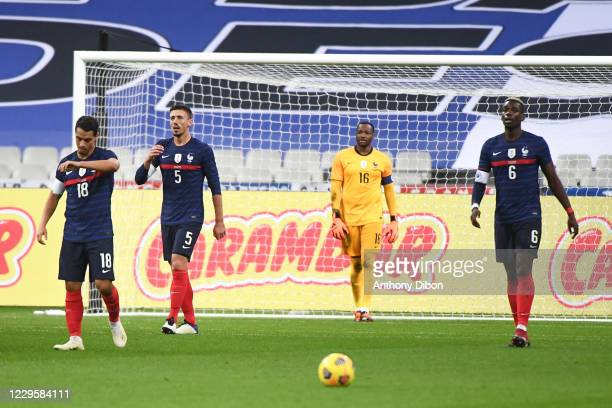 Wissam BEN YEDDER of France, Clement LENGLET of France, Steve MANDANDA of France and Paul POGBA of France dejected during the international friendly...