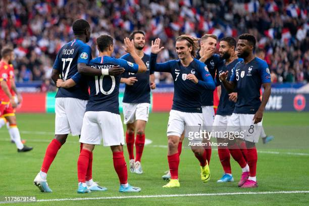 Wissam Ben Yedder of France is congratulated by teammates after scoring during UEFA Euro 2020 qualifier match between France and Andorra at Stade de...