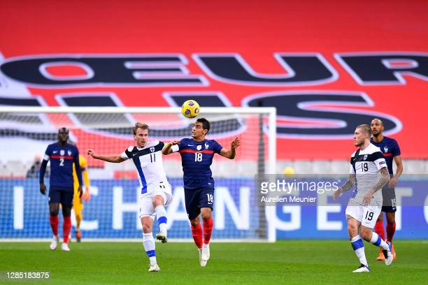 Wissam Ben Yedder of France jumps for the ball during the international friendly match between France and Finland at Stade de France on November 11,...