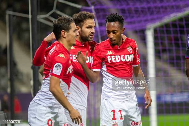 December 04: Wissam Ben Yedder of Monaco is congratulated by Cesc Fabregas of Monaco and goalscorer Gelson Martins of Monaco after setting up the...