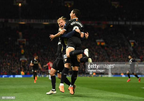 Wissam Ben Yedder of Sevilla celebrates as he scores their first goal with Johannes Geis of Sevilla during the UEFA Champions League Round of 16...