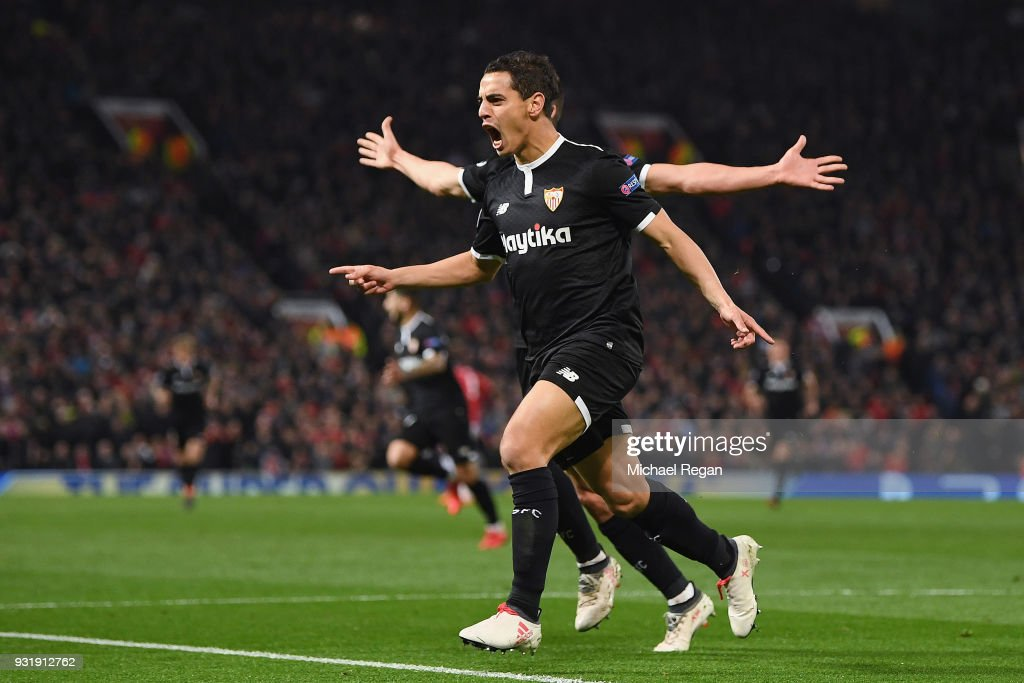 Wissam Ben Yedder of Sevilla (front) celebrates as he scores their first goal during the UEFA Champions League Round of 16 Second Leg match between Manchester United and Sevilla FC at Old Trafford on March 13, 2018 in Manchester, United Kingdom.