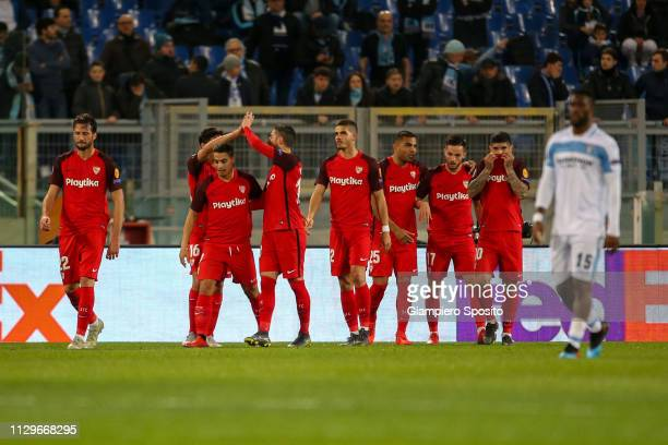 Wissam Ben Yedder of Sevilla celebrates with teammates after scoring during the UEFA Europa League Round of 32 First Leg match between SS Lazio and...