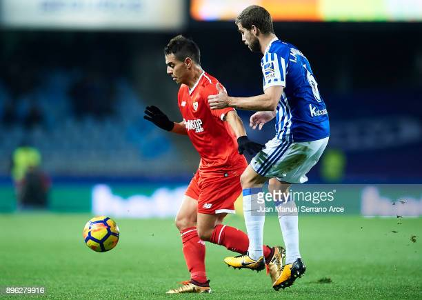 Wissam Ben Yedder of Sevilla FC being followed by Inigo Martinez of Real Sociedad during the La Liga match between Real Sociedad and Sevilla at...