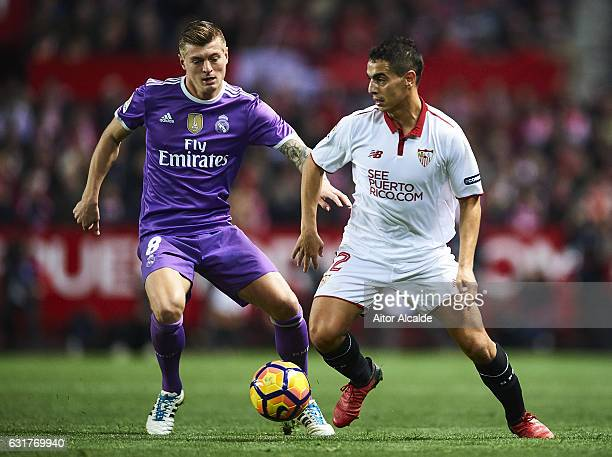 Wissam Ben Yedder of Sevilla FC being followed by Toni Kroos of Real Madrid CF during the match against Real Madrid CF during the La Liga match...