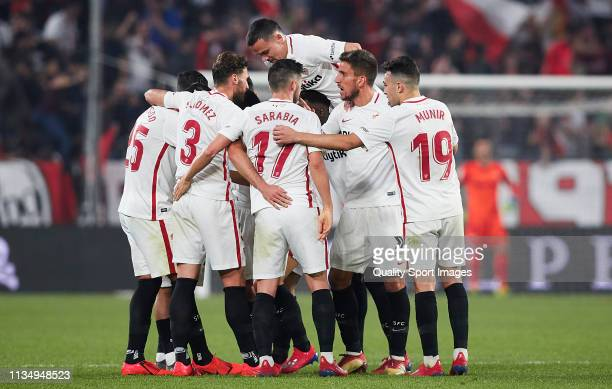 Wissam Ben Yedder of Sevilla FC celebrates scoring his team's fourth goal with team mates during the La Liga match between Sevilla FC and Real...
