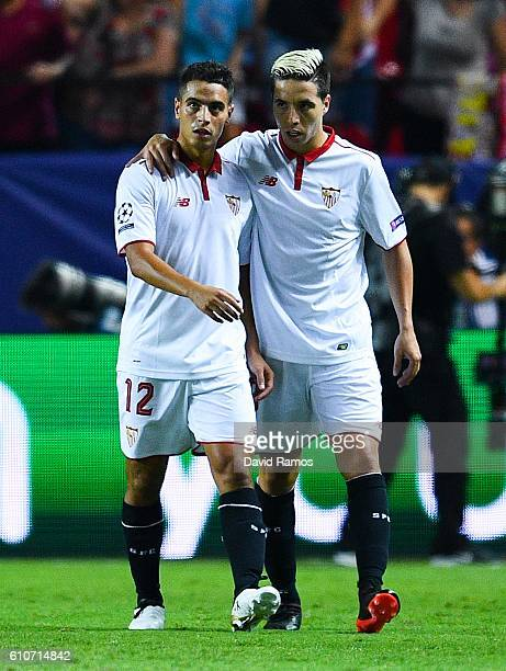 Wissam Ben Yedder of Sevilla FC celebrates with his team mate Samir Nasri of Sevilla FC after scoring his team's first goal during the UEFA Champions...