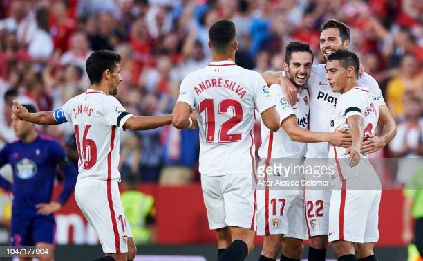 Wissam Ben Yedder of Sevilla FC celebrates with his teammates Franco Vazquez and Pablo Sarabia of Sevilla FC after scoring his team's second goal...