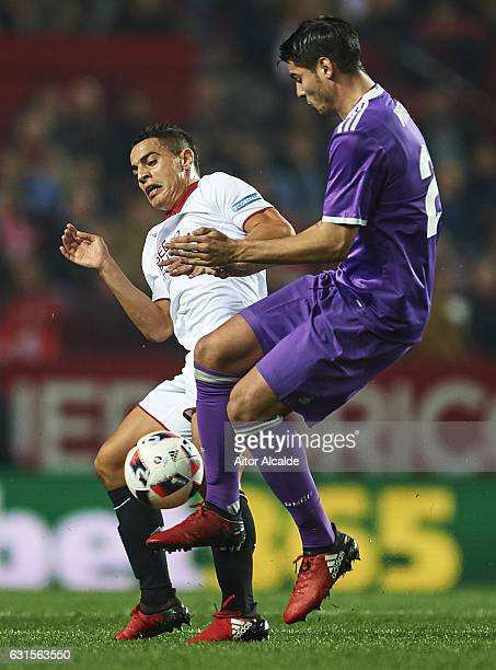 Wissam Ben Yedder of Sevilla FC competes for the ball with Alvaro Morata of Real Madrid CF during the Copa del Rey Round of 16 Second Leg match...