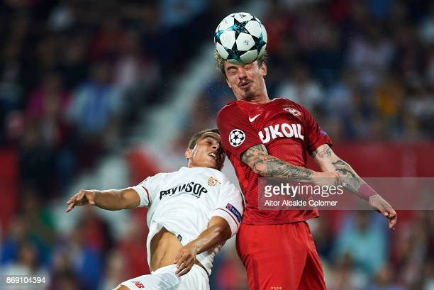Wissam Ben Yedder of Sevilla FC competes for the ball with Andrei Eschenko of FC Spartak Moskva during the UEFA Champions League group E match...