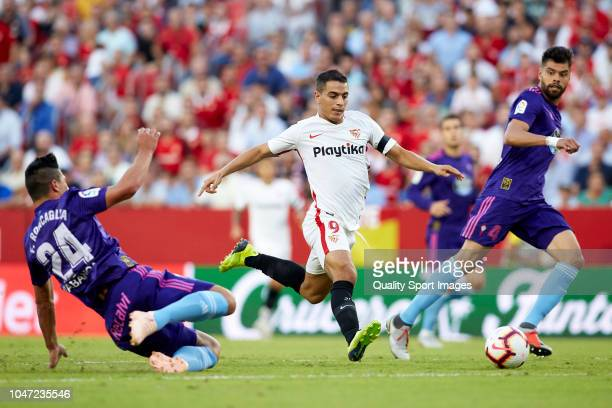 Wissam Ben Yedder of Sevilla FC competes for the ball with Facundo Roncaglia of RC Celta de Vigo during the La Liga match between Sevilla FC and RC...