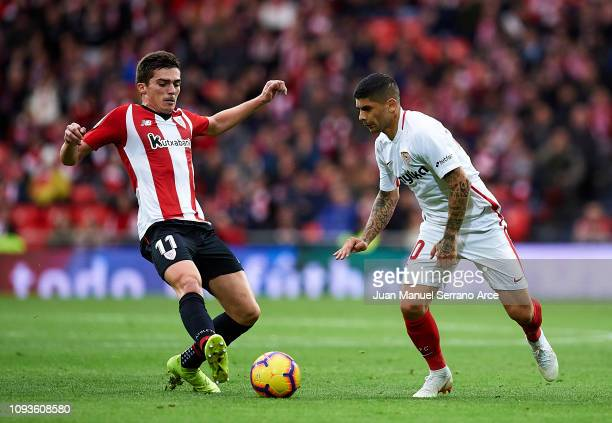 Wissam Ben Yedder of Sevilla FC competes for the ball with Inigo Cordoba of Athletic Club during the La Liga match between Athletic Club and Sevilla...
