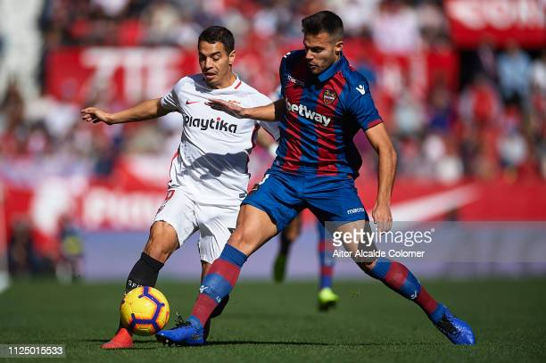 Wissam Ben Yedder of Sevilla FC competes for the ball withRoberto Suarez Pier of Levante UD during the La Liga match between Sevilla FC and Levante...