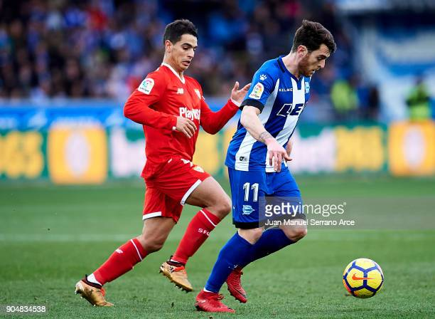 Wissam Ben Yedder of Sevilla FC duels for the ball with Ibai Gomez of Deportivo Alaves during the La Liga match between Deportivo Alaves and Sevilla...