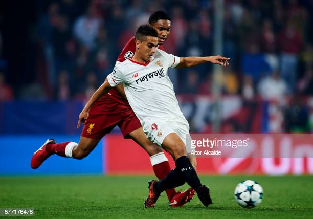 Wissam Ben Yedder of Sevilla FC duels for the ball with Joe Gomez of Liverpool FC during the UEFA Champions League group E match between Sevilla FC...