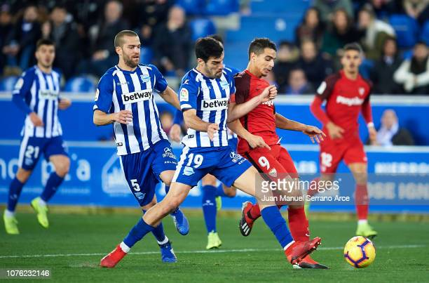 Wissam Ben Yedder of Sevilla FC duels for the ball with Manuel Garcia of Deportivo Alaves during the La Liga match between Deportivo Alaves and...