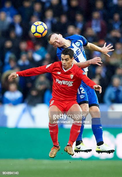 Wissam Ben Yedder of Sevilla FC duels for the ball with Rodrigo Ely of Deportivo Alaves during the La Liga match between Deportivo Alaves and Sevilla...