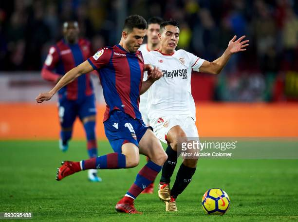 Wissam Ben Yedder of Sevilla FC duels for the ball with Sergio Postigo of Levante UD during the La Liga match between Sevilla FC and Levante UD at...