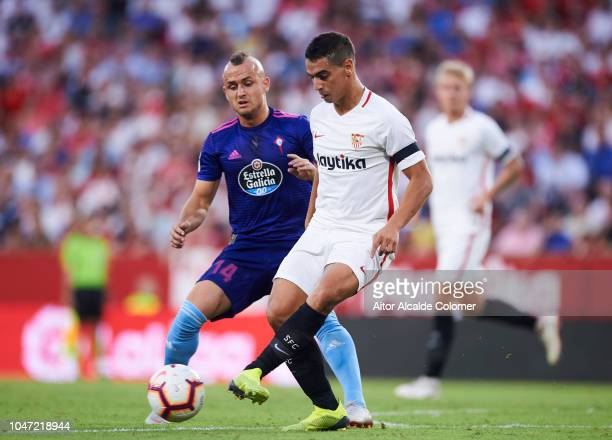 Wissam Ben Yedder of Sevilla FC duels for the ball with Stanislav Lobotka of RC Celta de Vigo during the La Liga match between Sevilla FC and RC...