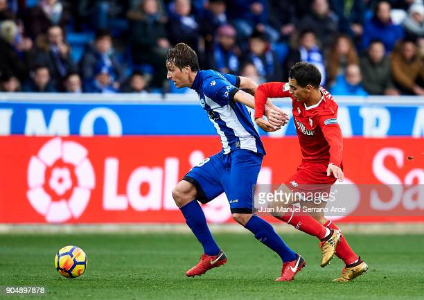 Wissam Ben Yedder of Sevilla FC duels for the ball with Tomas Pina of Deportivo Alaves during the La Liga match between Deportivo Alaves and Sevilla...