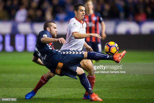 Wissam Ben Yedder of Sevilla FC duels for the ball with Victor Laguardia of Deportivo Alaves during the La Liga match between Deportivo Alaves and...