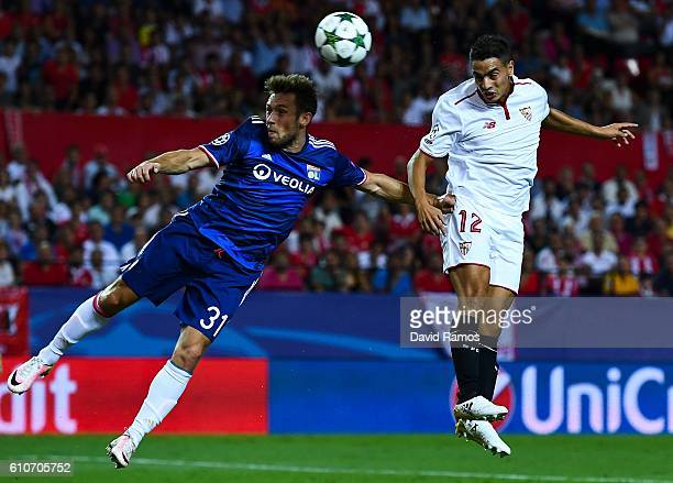 Wissam Ben Yedder of Sevilla FC scores a disallowed goal past Maciej Rybus of Olympique Lyonnais during the UEFA Champions League Group H match...