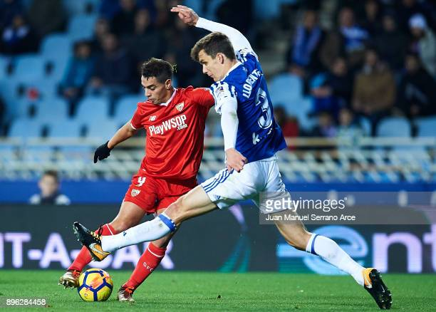 Wissam Ben Yedder of Sevilla FC shoots for score the first goal for Sevilla FC while is being followed by Diego Llorente of Real Sociedad during the...