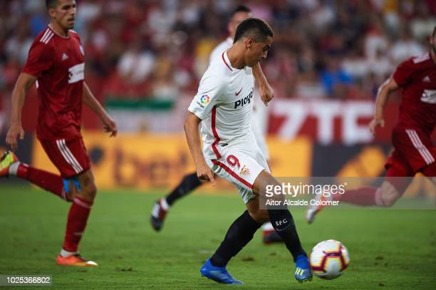 Wissam Ben Yedder of Sevilla FC shoots on target and scores the third goal of his team during the UEFA Europa League Play Off Second Leg match...