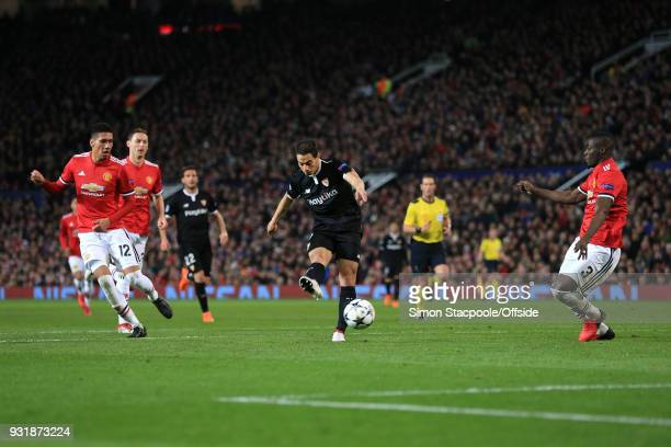Wissam Ben Yedder of Sevilla scores their 1st goal during the UEFA Champions League Round of 16 Second Leg match between Manchester United and...