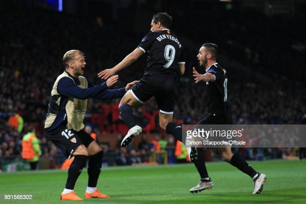 Wissam Ben Yedder of Sevilla scores their 1st goal with team mates during the UEFA Champions League Round of 16 Second Leg match between Manchester...