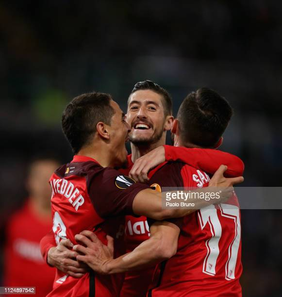 Wissam Ben Yedder with his teammates of Sevilla celebrates after scoring the opening goal during the UEFA Europa League Round of 32 first leg match...
