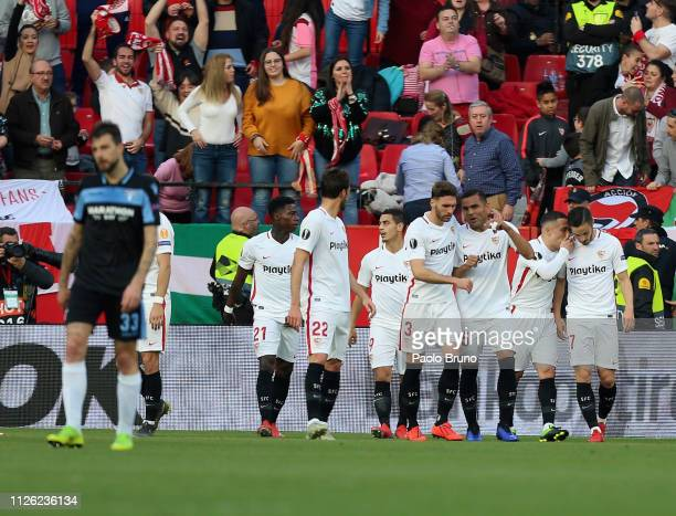 Wissam Ben Yedder with his teammates of Sevilla celebrates after scoring the opening goal during the UEFA Europa League Round of 32 Second Leg match...