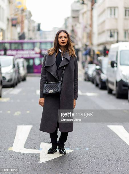 Wissame Boubekeur wearing a grey wool coat and a Chanel bag outside Marques Almeida during London Fashion Week Spring/Summer collections 2017 on...