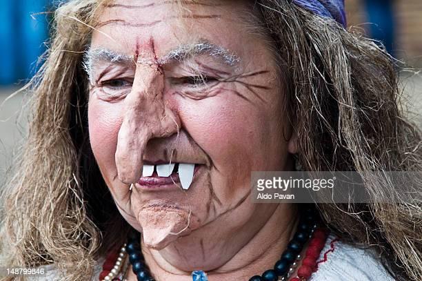 witch at yarmarok, traditional fair. - donna brutta foto e immagini stock