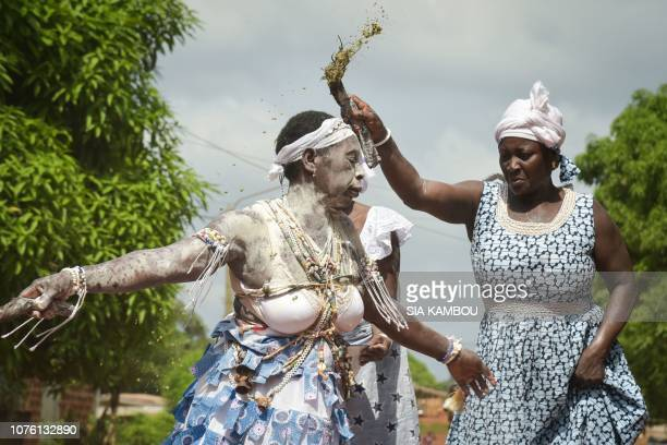Witch doctor or komians dance and throw kaolin during the purification ceremony of a komian widow in Amelekia on November 28 2018 At the Adjoua...